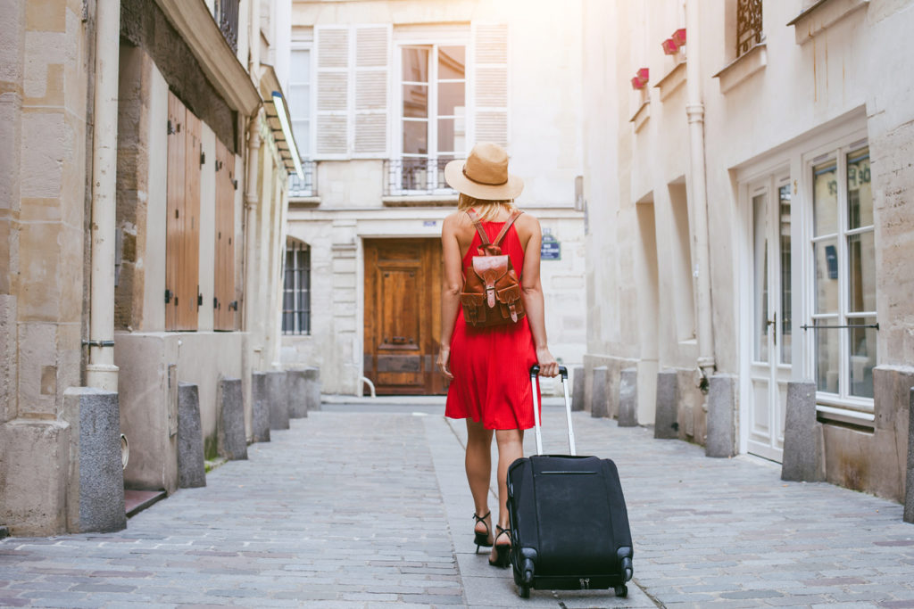 picture of adventure hobbies for moms -travel background, woman tourist walking with suitcase on the street in european city, tourism in Europe