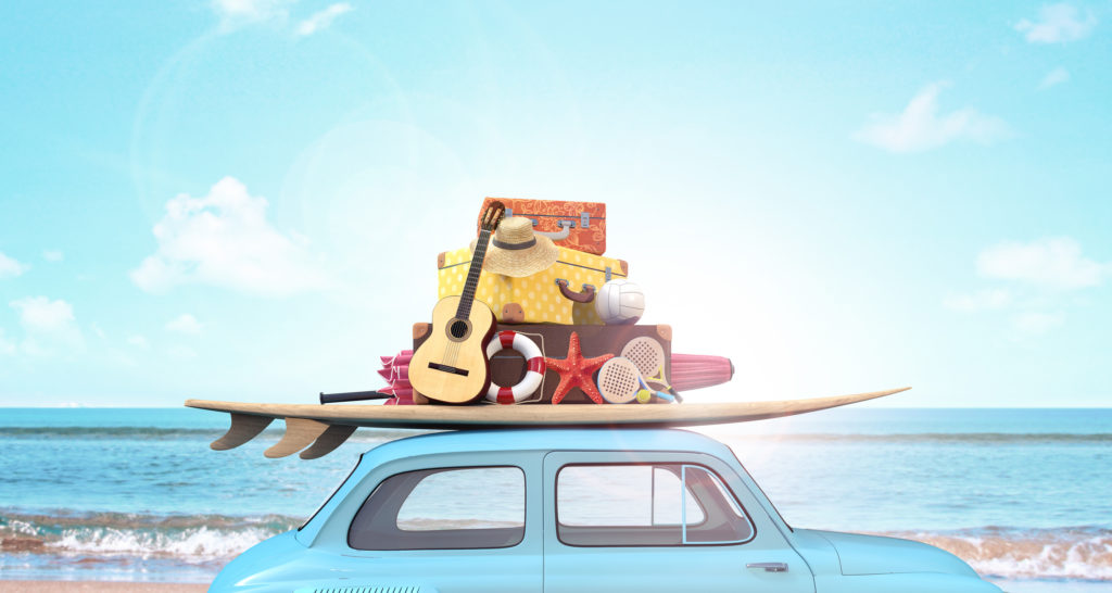 Car with luggage on the roof ready for summer vacation represents outdoor hobbies for moms