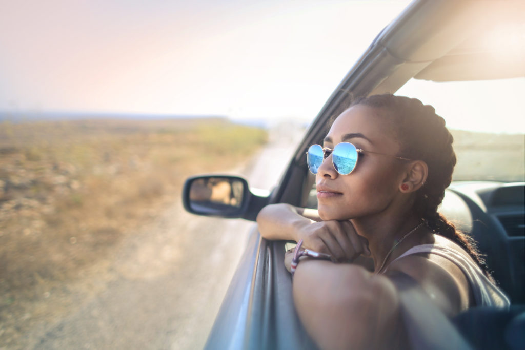 Beautiful woman looking out from a car's window